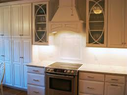 the graceful curves of the palladia style glass cabinet doors by kraftmaid