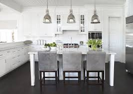 other kitchen pendant lighting traditional crown molding dark stained wood floor floating shelves gray leather counter stools kitchen island marble pendant