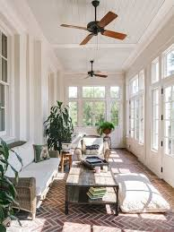 Example of a large classic brick floor and red floor sunroom design in  Other with a