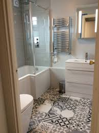 White Bathroom Suite These Funky Patterned Floor Tiles Look Fantastic Against The Crisp