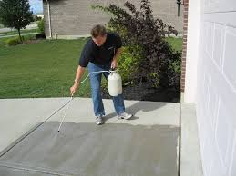 cement driveway sealer.  Cement Person Sealing Concrete Driveway Throughout Cement Driveway Sealer N