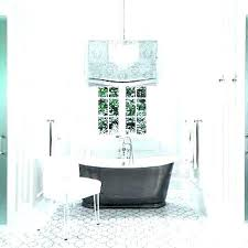 chandelier over bathtub chandeliers designs tub code tiered crystal flanked soaking