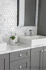 white bathroom cabinets gray walls. formica calacatta marble laminate countertop, hexagon mosaic backsplash and chelse gray vanity in ensuite bathroom with raised sinks by kylie m white cabinets walls t