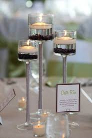 3 piece stemmed glass candle holders with floating candles