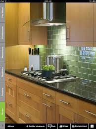 green glass tile backsplash for kitchen with white cabinets walls grey floors countertops