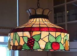 this is an original stained glass chandelier it has only a few very minor ed pieces no chips missing it is large and has exceptional color