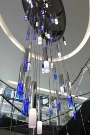 office lighting solutions. bespoke atrium chandelier jones day london commercial office lighting design manufacture solutions