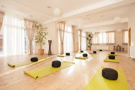 attractive large yoga studio e with new light wood flooring lots of windows and plants