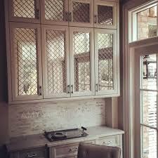 Mirrored Kitchen Cabinet Doors Amy Vermillion Interiors Antique Mirror Behind Nickel Wire