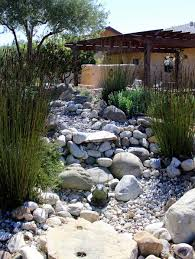 Small Picture Using pebbles and rocks you can create a dry river bed that