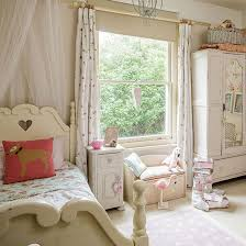Neutral shabby chic girl's bedroom with painted bed