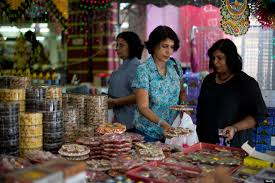photo essay diwali the festival of lights why i love hinduism n women browse cookies ahead of the upcoming diwali festival celebrations in the brickfields area