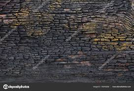 abstract old black gold bark wood background wall texture grunge color photo by nestampak