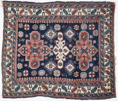 antique caucasian kazak area rug 48 1 2 x 42 1 2 wool on wool 3 medallions dark blue field rust cream and ivory other colors of blues