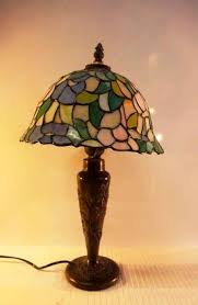 tiffany style table lamp with stained glass in fl patterns standing on a bronze