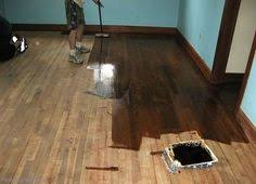 how to properly refinish floors sarah i love the wood border with the blue paint