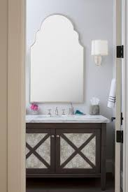 Blue Bath Vanity With Uttermost Kenitra Arch Wall Mirror Arched