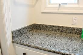 which is why the granite backsplash around the bathroom sink which happens to live in a nook on one wall of our master bedroom had to go
