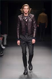 a model takes the catwalk during milan fashion week in a leather jacket by salvatore ferragamo