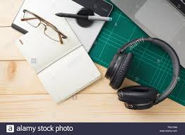 Graphic Designer Stuff Top View Of Stuff And Gadgets On Wooden Desk With Graphic