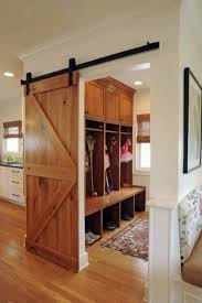 <3 sliding barn doors inside the house. This would be great between mudroom  and