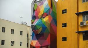 geometric bear wall art by okuda san miguel on geometric bear wall art with colorful geometric bear mural appears to pop out of the building