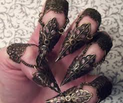 sharp finger claws. bronze elven leaf claw sharp finger claws r