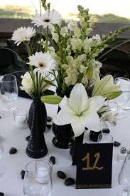 black and white wedding floral | table 12 white flower centerpieces by  Belvedere Flowers for The