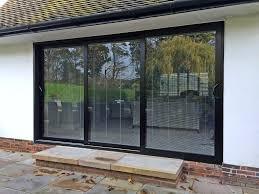 convert window to sliding door cost replace sliding patio door with hinged door how to install an exterior door in a brick wall center swing patio doors