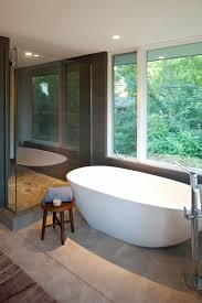 bathroom ideas white acrylic free standing tub and shower added steel standing faucet and brown stained wood small stool elegance stand alone bathtubs