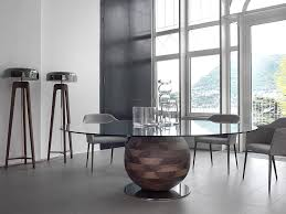 view in gallery dining table with base in solid walnut and temepered glass top