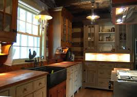 here s a really nice kitchen but i try to persuade my clients away from having a log kitchen because a the kitchen cabinets cover up most of the logs