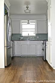 small white kitchen makeover with built in fridge enclosure by kaylor of fisherman s wife furniture