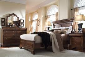 Modern Brown Wood Bedroom Furniture Set On The Grey Rug Also Beige