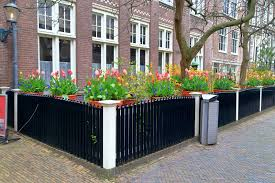 Fence planter boxes with tulips