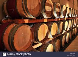stacked oak barrels. Stacked Oak Wine Barrels In Winery Cellar T
