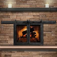 the paterson sliding masonry fireplace door is truly a work of art it features a barn door theme with rivet detail easily sliding open and shut with the