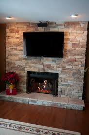 have not had any tv s that have been damaged by the heat below are some images that show a few of our stone fireplaces with televisions mounted above