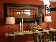 burnt orange paint color with dark accent furniture accent wall color love the window burnt orange living room furniture