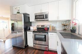 small kitchen with white theril cabinets andgray quartz