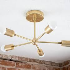 modern chandelier gold five 5 arm pinwheel bulb b