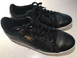 puma black leather tennis shoes with gold logo 6 5 women s puma shoes puma