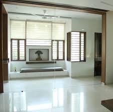 pooja room with glass doors