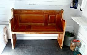 make a farmhouse bench from repurposed door see how we did it at knick of