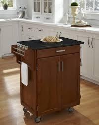 luxury kitchen style ideas with dark brown wooden movable kitchen islands silver wheels white painted kitchen cabinet and black cement kitchen island