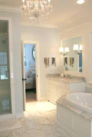 carrera marble bathroom white traditional with baseboards storage chandelier image by carrara designs