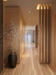 interior: Artistick Plant On Black Planter On Wooden Floor Fit To  Mesmerizing Hallway Designs With