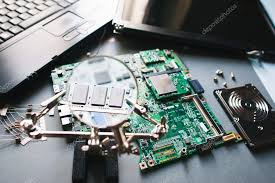 electronic parts of pc motherboard display monitor hdd ysis computer ram memory through magnifying glass