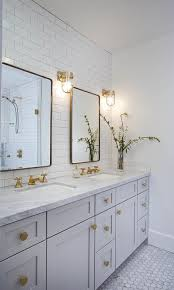 ideal lighting for a master bathroom consists of ceiling and wall lighting at the right height placement is key secondary baths and powder rooms can be