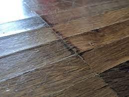 hardwood floor buckling how to fix it
